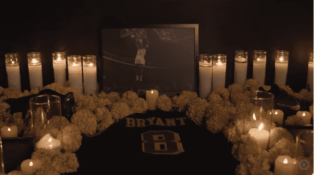 Candles and flowers around Kobe Bryant's jersey back in November 2016 | Source: YouTube/The Ringer