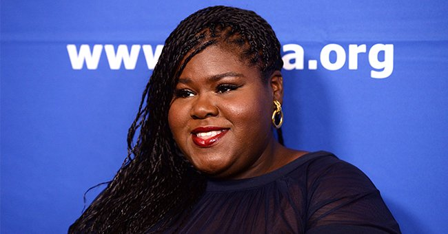 Gabby Sidibe Poses on a Swing during Outing with Her Boyfriend in Tight Pink Shorts & a Blouse