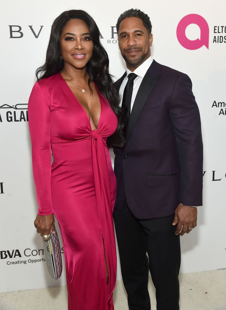Kenya Moore and Marc Daly attend the 26th annual Elton John AIDS Foundation's Academy Awards Viewing Party at The City of West Hollywood Park | Photo: Getty Images