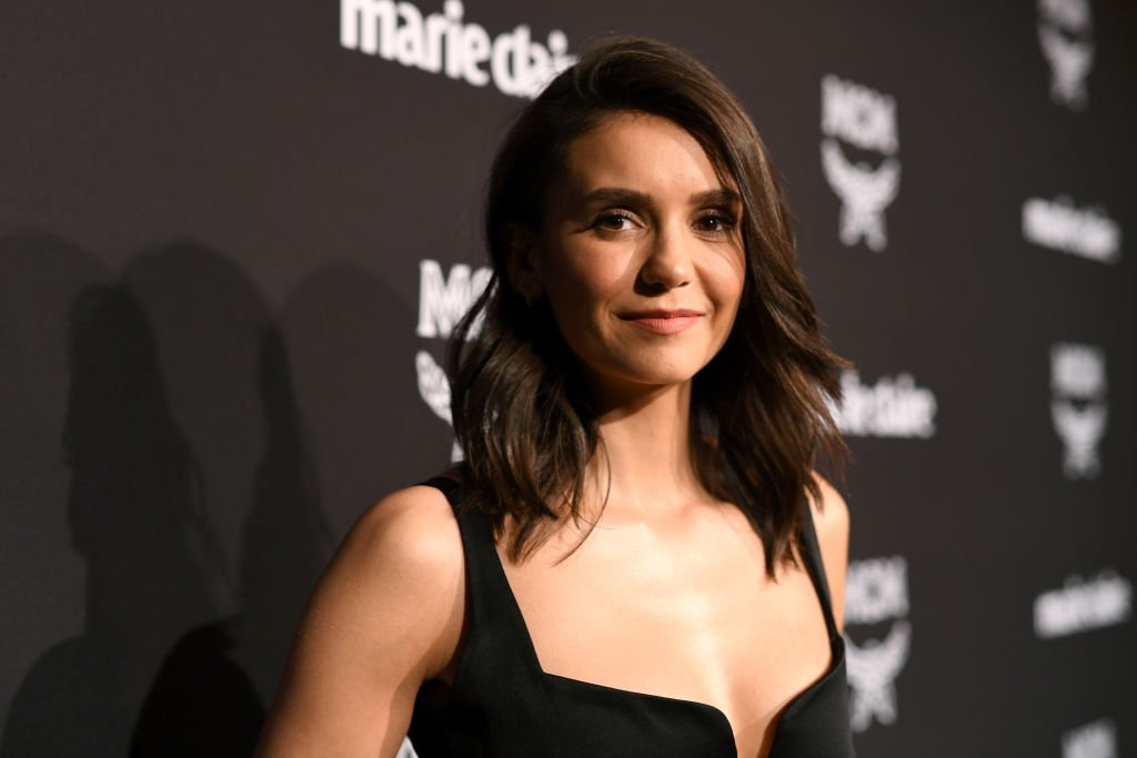 Nina Dobrev looking elegant in black at a Marie Claire event in Los Angeles on March 12, 2019. | Photo: Getty Images.