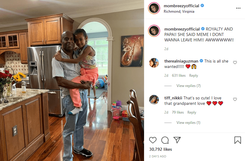 Clinton Brown and his daughter Royalty Brown, looking adorable in a picture | Photo: Instagram/mombreezyofficial
