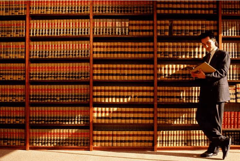 Lawyer reading in a library | Source: Getty Images