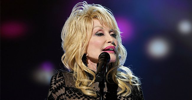 Dolly Parton Looks Magnificent on the Cover of a Magazine in a Red Glittering Dress