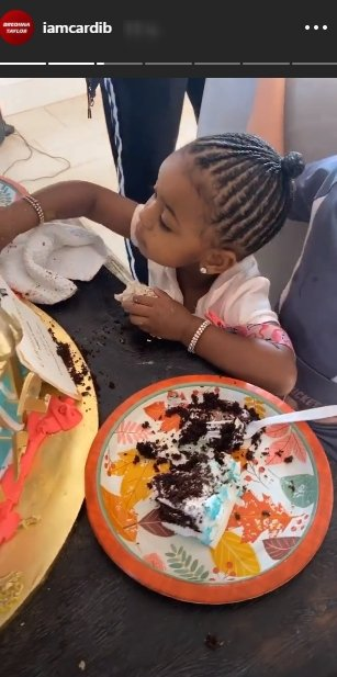 A picture of Kulture eating some cake on her mom's birthday. | Photo: Instagram/Iamcardib