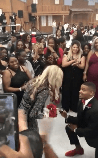 Solomon McGuinty gets down on one knee and proposes to his girlfriend during his sister's wedding. | Source: twitter/devon0jones
