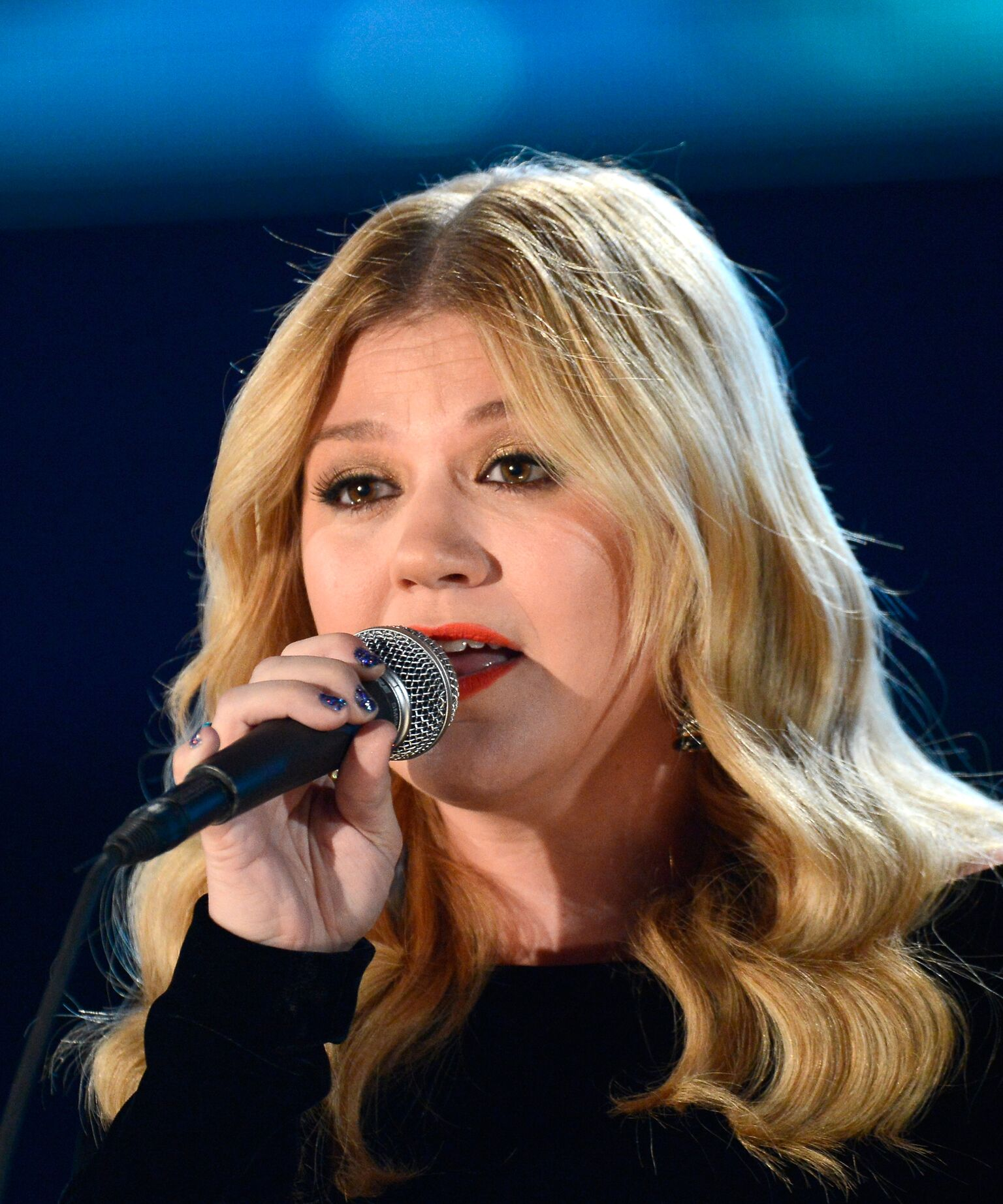 Kelly Clarkson performs onstage at the 55th Annual GRAMMY Awards at Staples Center | Getty Images