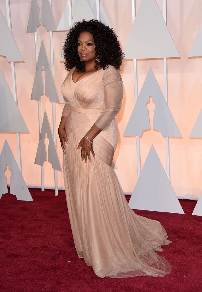 "Oprah Winfrey attending the 87th Academy Awards on February 22, 2015. More than three decades ago, she was nominated for Best Supporting Actress for her role in ""The Color Purple"" but lost to Anjelica Huston. 