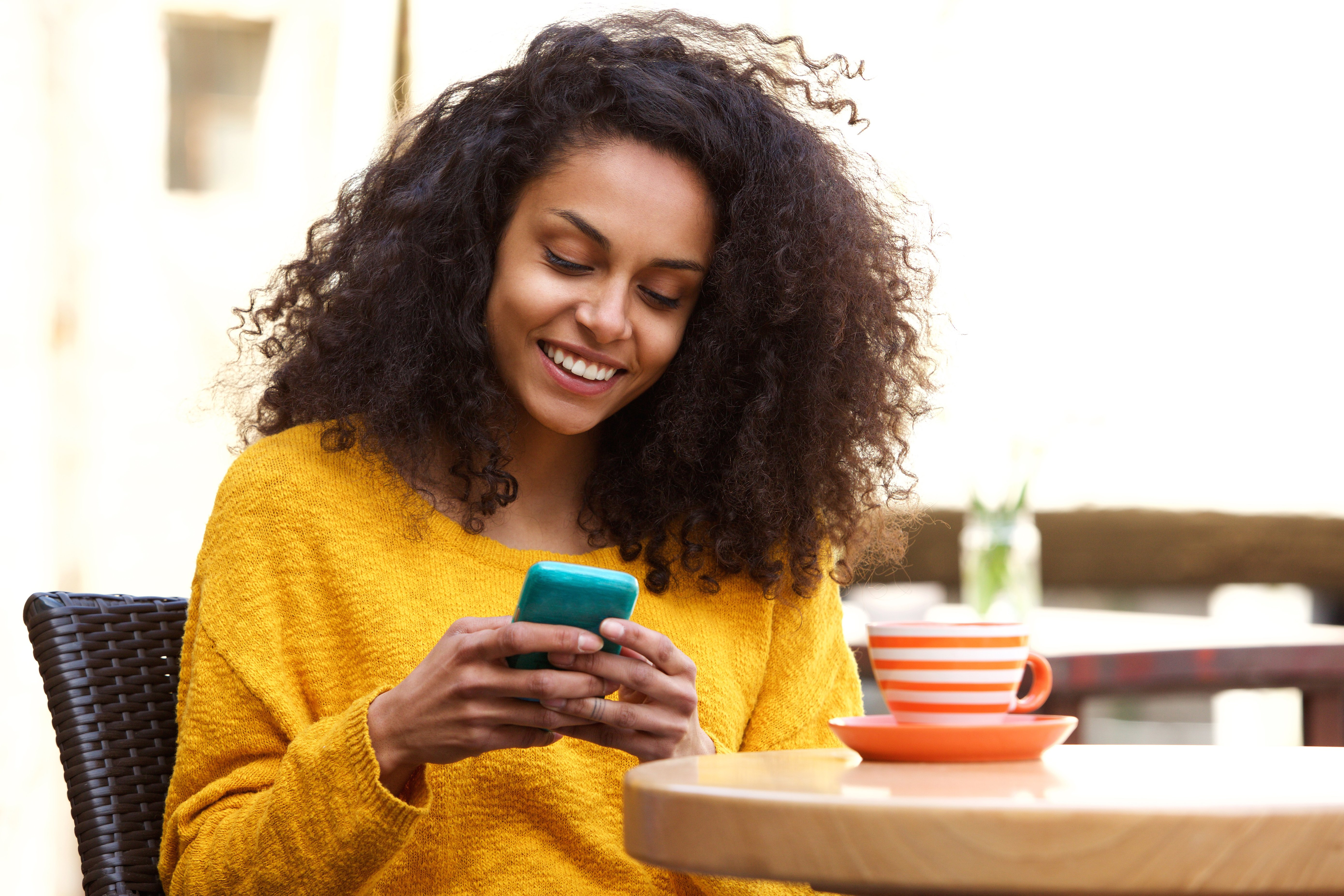 Woman texting   Source: Shutterstock