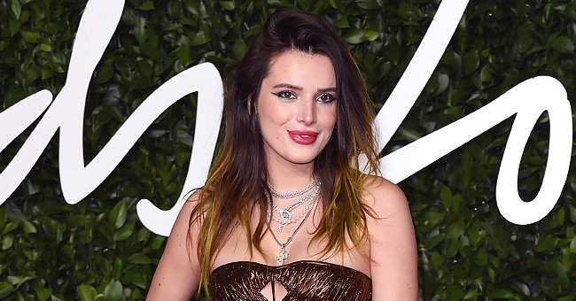 US Weekly: Bella Thorne Gets Candid about Having to Perform in Swan Mask and Costume on 'The Masked Singer