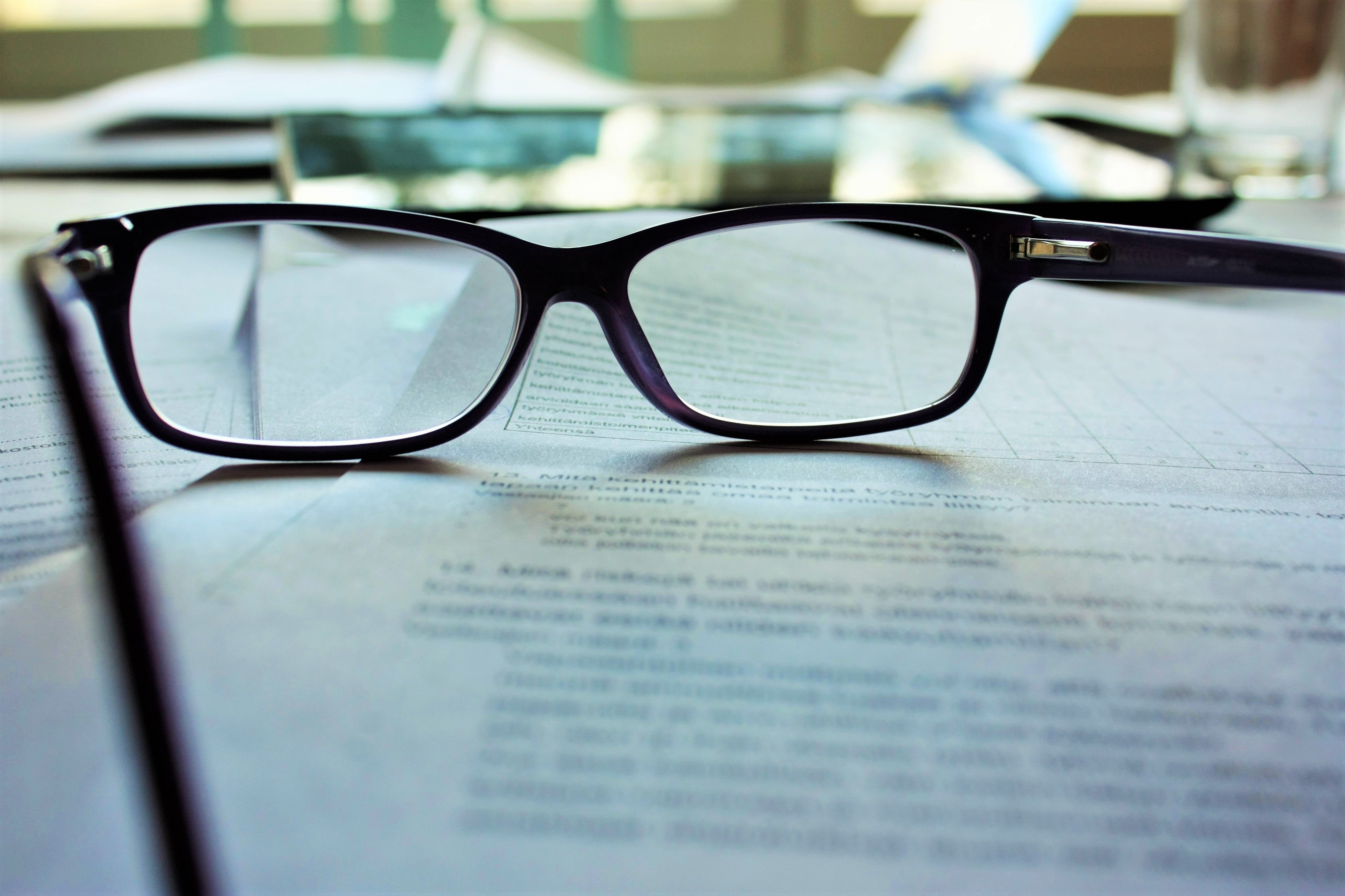 Reading glasses and papers | Source: Unsplash