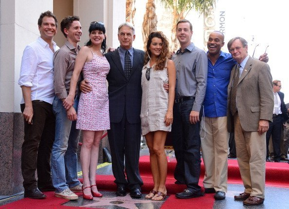 Actors Michael Weatherly, Brian Dietzen, Pauley Perrette, Mark Harmon, Cote de Pablo, Sean Murray, Rocky Caroll and David McCallum pose as actor Mark Harmon is honored with the 2,482nd star on the Hollywood Walk of Fame on October 1, 2012, in Hollywood, California. | Source: Getty Images.