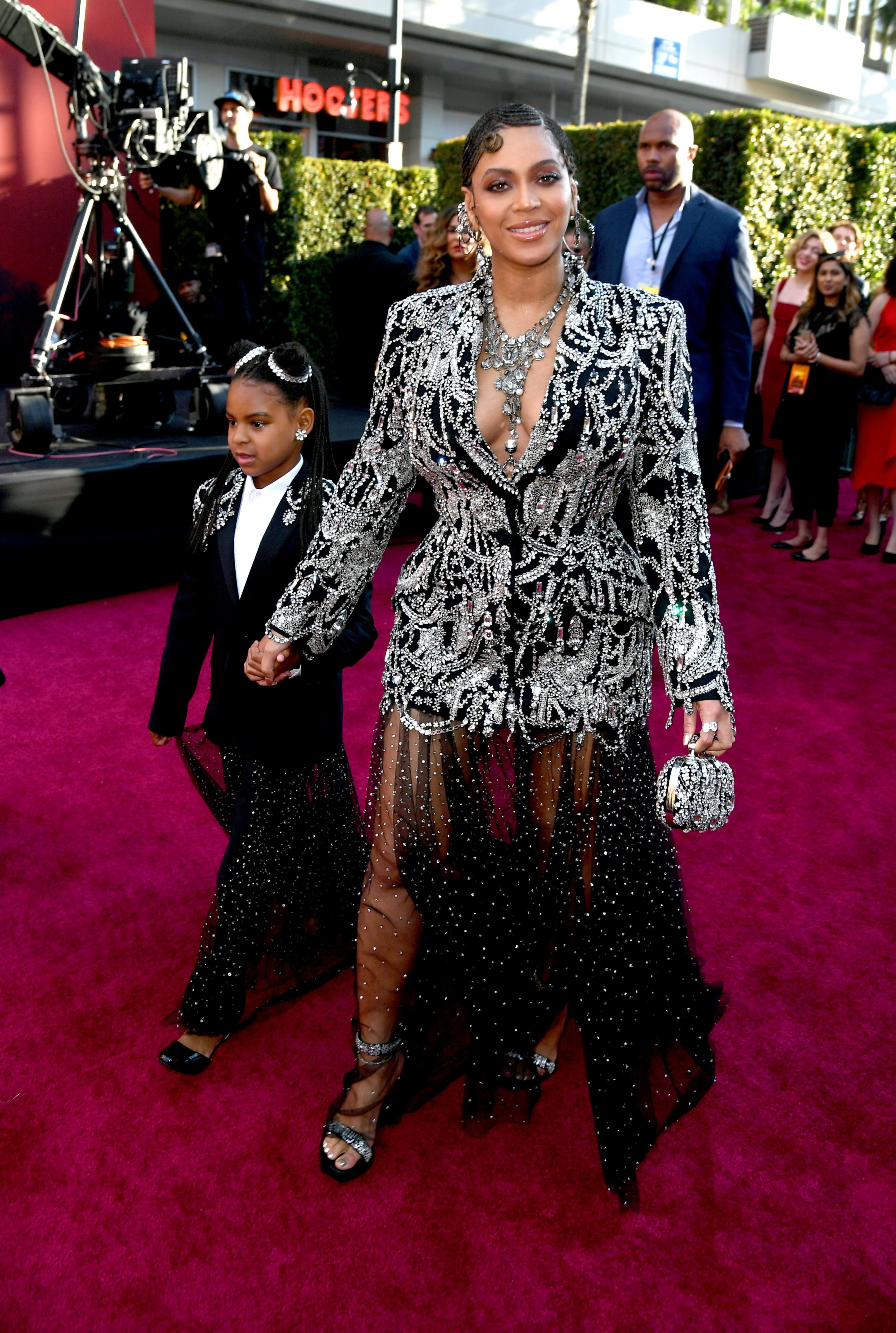 "Beyonce attends the Hollywood premiere of ""The Lion King"" with her daughter, Blue Ivy Carter in July 2019. 
