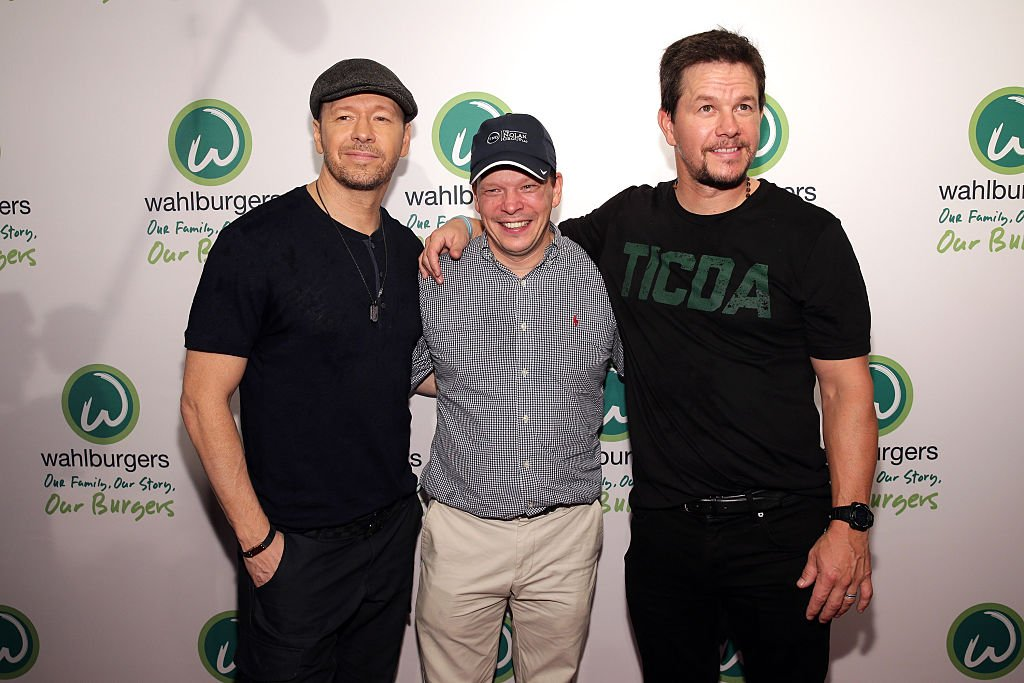 Donnie Wahlberg, Paul Wahlberg and Mark Wahlberg attend the Wahlburgers Coney Island Preview Party in Brooklyn, New York on June 23, 2015 | Photo: Getty Images