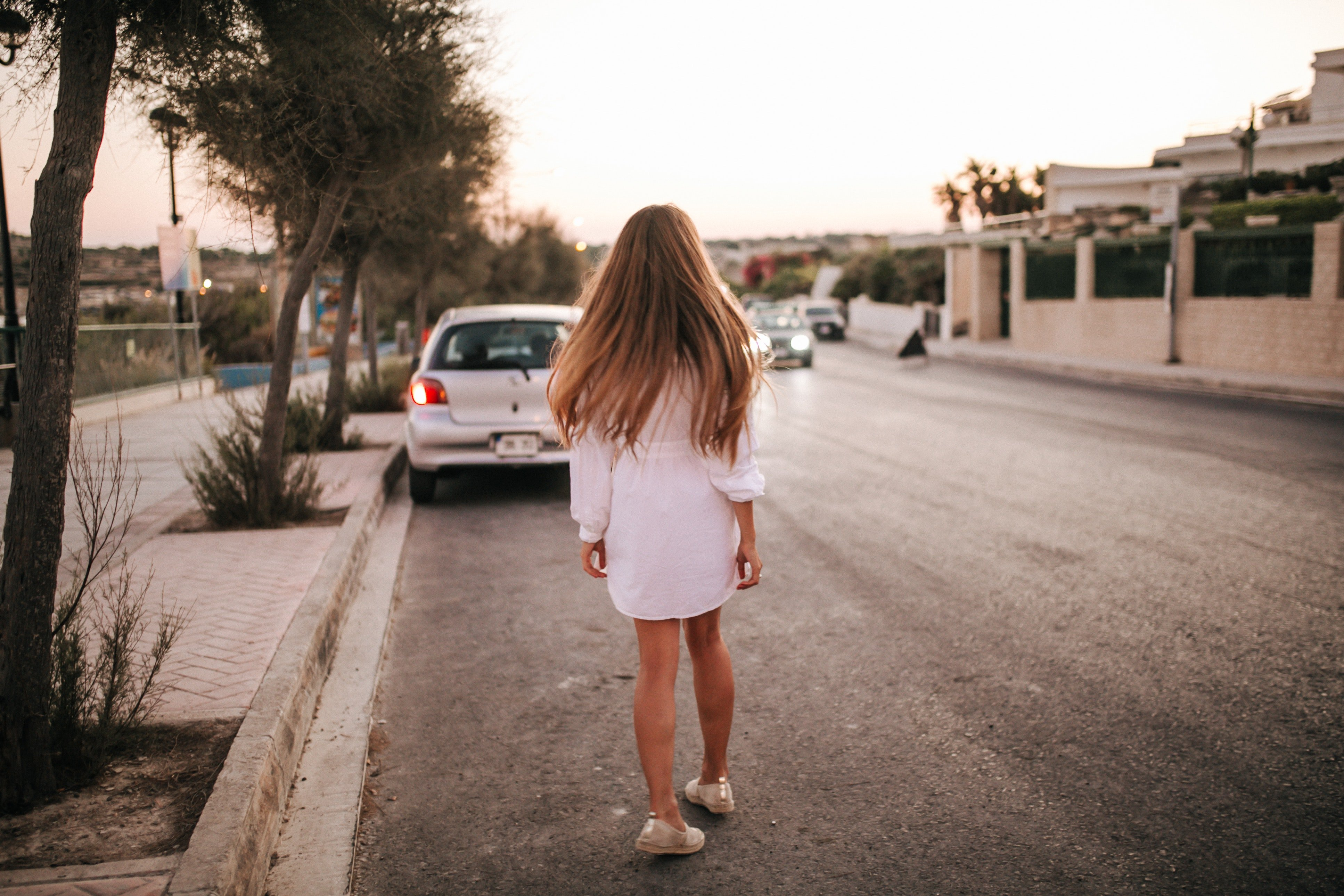 A woman walking on deserted road   Photo: Pexels
