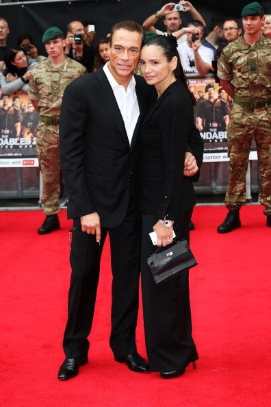 "Jean-Claude Van Damme (L) and Gladys Portugues attend ""The Expendables 2"" UK film premiere at Empire Leicester Square on August 13, 2012, in London, England. 