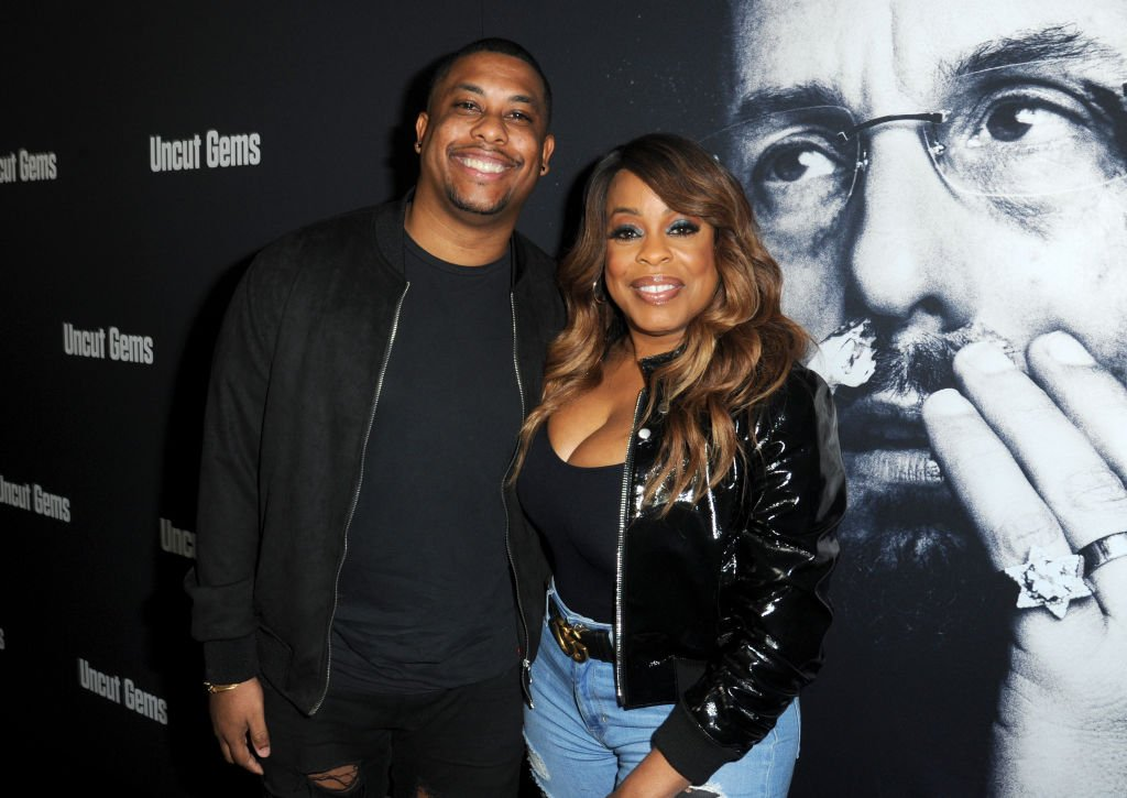 """Niecy Nash and her son Dominic Nash arrive at the premiere for """"Uncut Gems"""" on December 11, 2019, in Los Angeles, California 