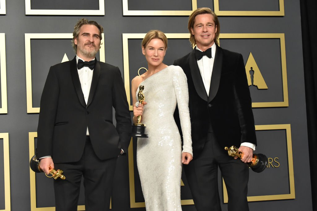 Joaquin Phoenix, Renée Zellweger, and Brad Pitt pose in the press room during the 92nd Annual Academy Awards at Hollywood and Highland on February 09, 2020. | Source: Getty Images