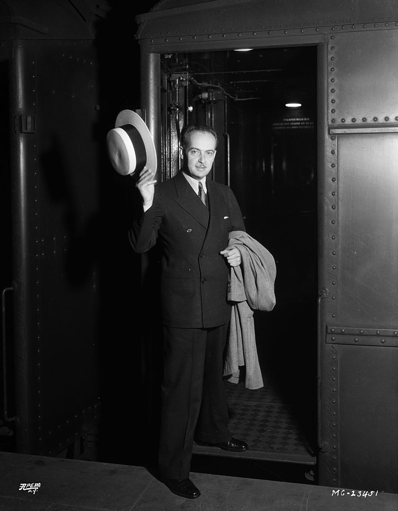 Producer Paul Bern (Paul Levy) (1889 - 1932), the second husband of MGM star Jean Harlow and Irving Thalberg's right-hand man, waving farewell as he boards a train. The marriage lasted only a few weeks ending in his suicide in September 1932. | Source: Getty Images