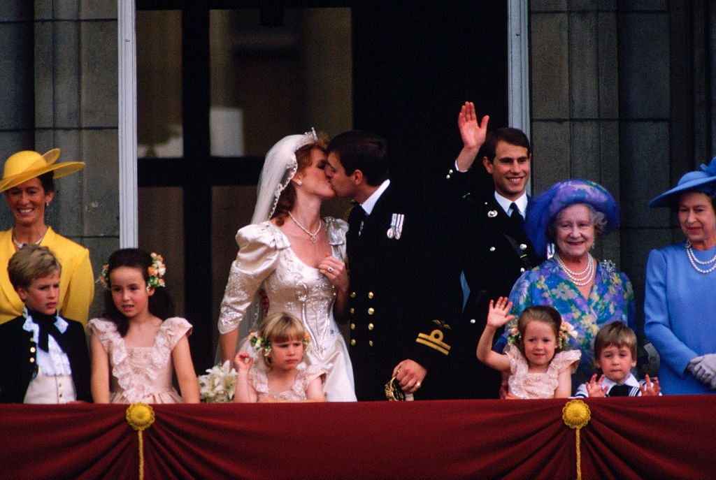 The Duke and Duchess of York and their wedding party stand on the balcony of Buckingham Palace after their wedding   Photo: Getty Images