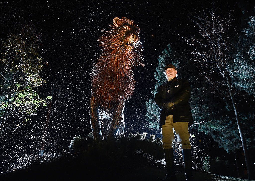 Douglas Gresham, the adopted son of the children's author CS Lewis stands beside a bronze sculpture of CS Lewis' most famous character the lion Aslan as he helps open CS Lewis Square | Getty Images
