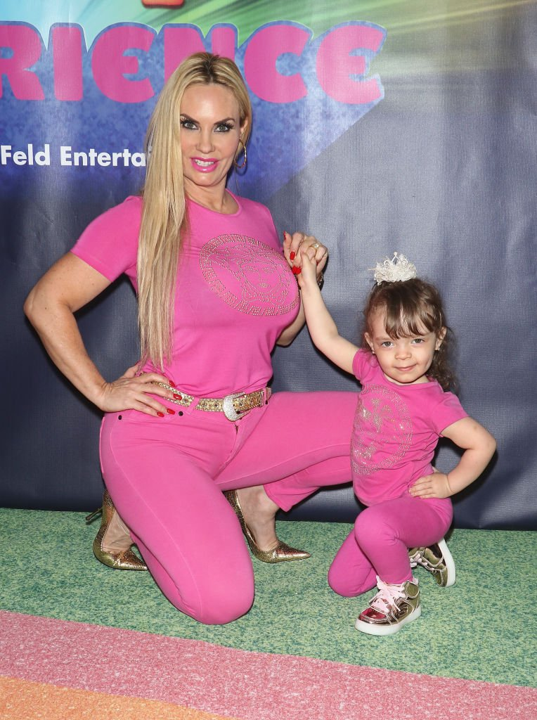 Coco Austin and her daughter Chanel Nicole Marrow pose with their hips to the side as the arrived at the Dreamworks Trolls The Experience opening on November 14, 2018, New York City | Source: Jim Spellman/Getty Images