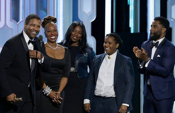 Denzel Washington accepts the Cecil B. Demille Award with his family at the Golden Globes | Photo: Getty Images
