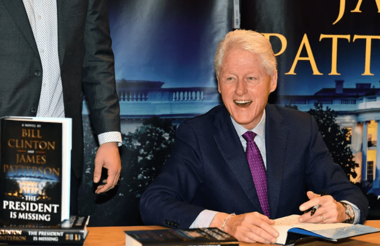 """Bill Clinton signs copies of his new book co-authored with James Patterson """"The President Is Missing"""" at Barnes & Noble on June 5, 2018 in New York City   Photo: Getty Images"""