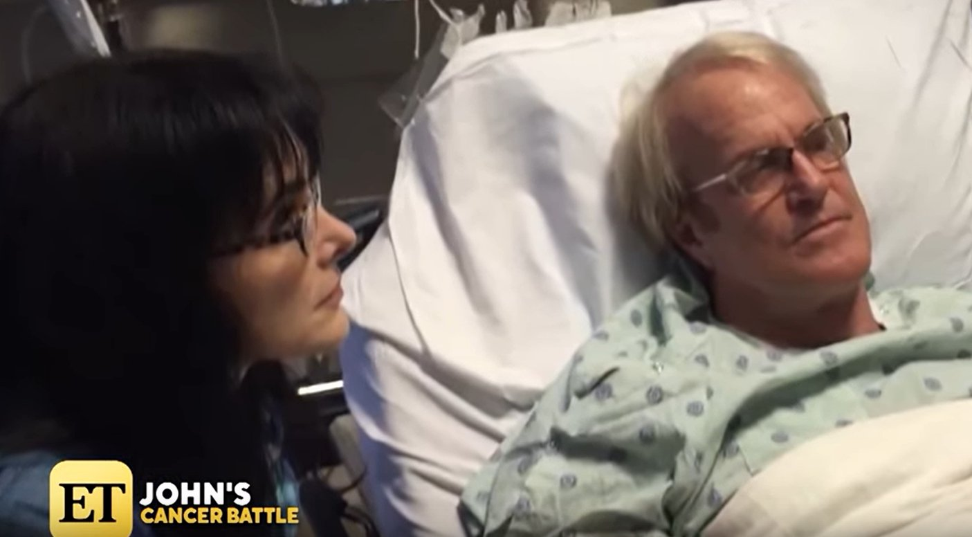 John Tesh in the hospital in throwback photo shared on Entertainment Tonight with Mary Hart | Photo: YouTube/ Entertainment Tonight