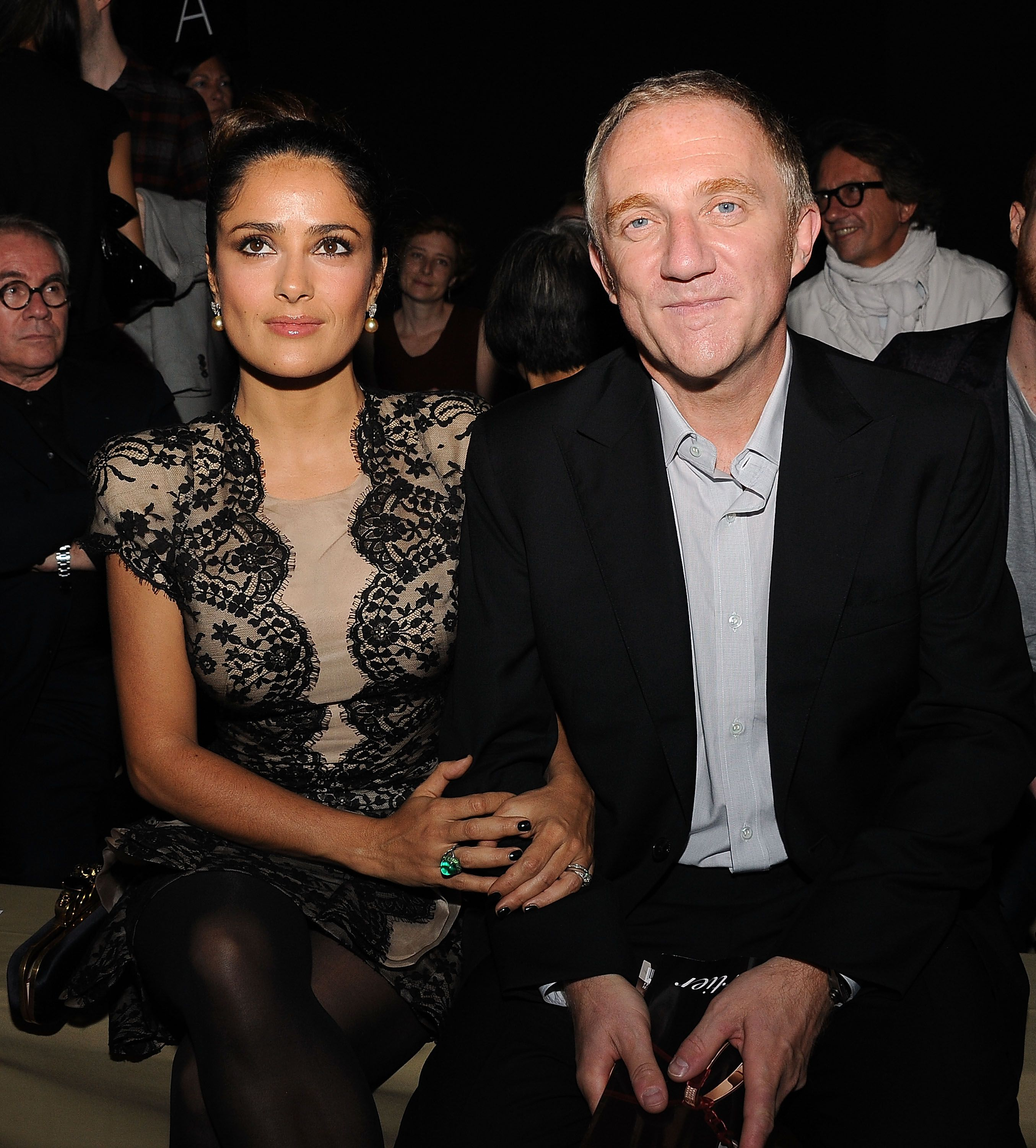 Salma Hayek and Francois-Henri Pinault during the Alexander McQueen Ready to Wear Spring/Summer show during Paris Fashion Week on October 5, 2010, in France. | Source: Getty Images