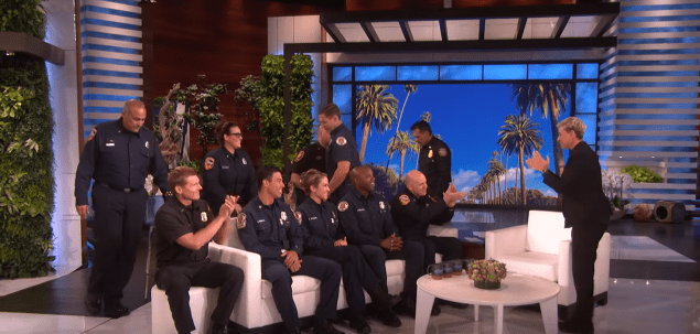 Ellen DeGeneres welcomes ten California firefighters on stage in tribute to their service. | Source: YouTube/TheEllenShow.