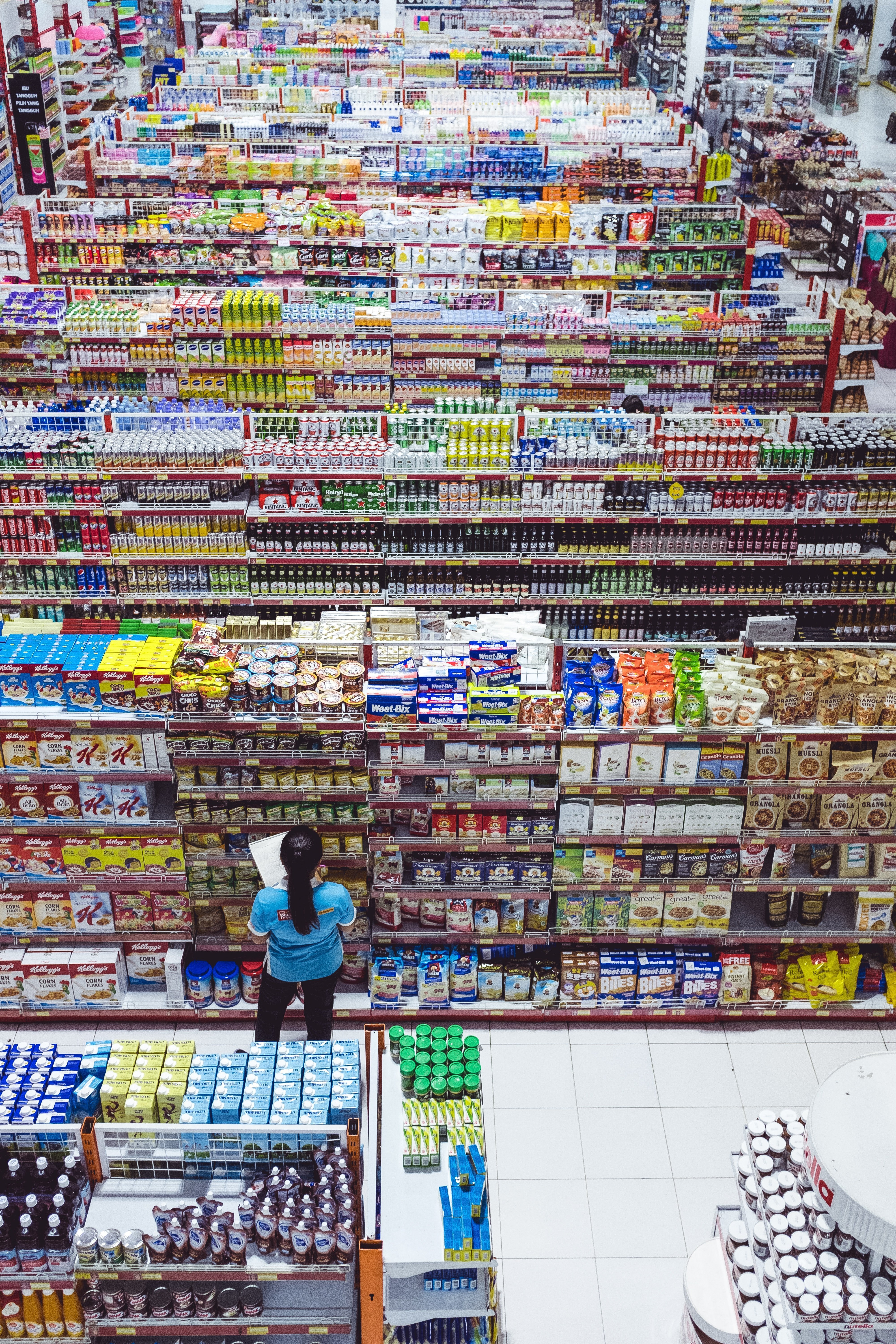 A manager checking the isles of a store | Source: Unsplash.com