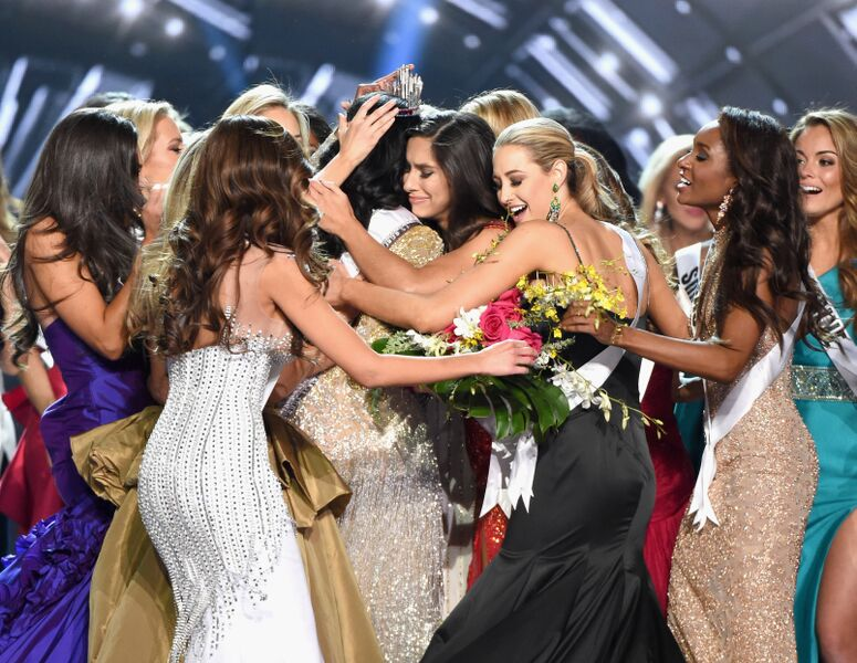 A powerful photo of beauty queens giving support to the crowned queen | Source: Getty Images/GlobalImagesUkraine