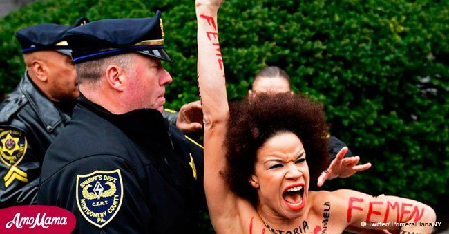 Half-naked black woman attacks Bill Cosby at a courthouse in Pennsylvania. Police intervened