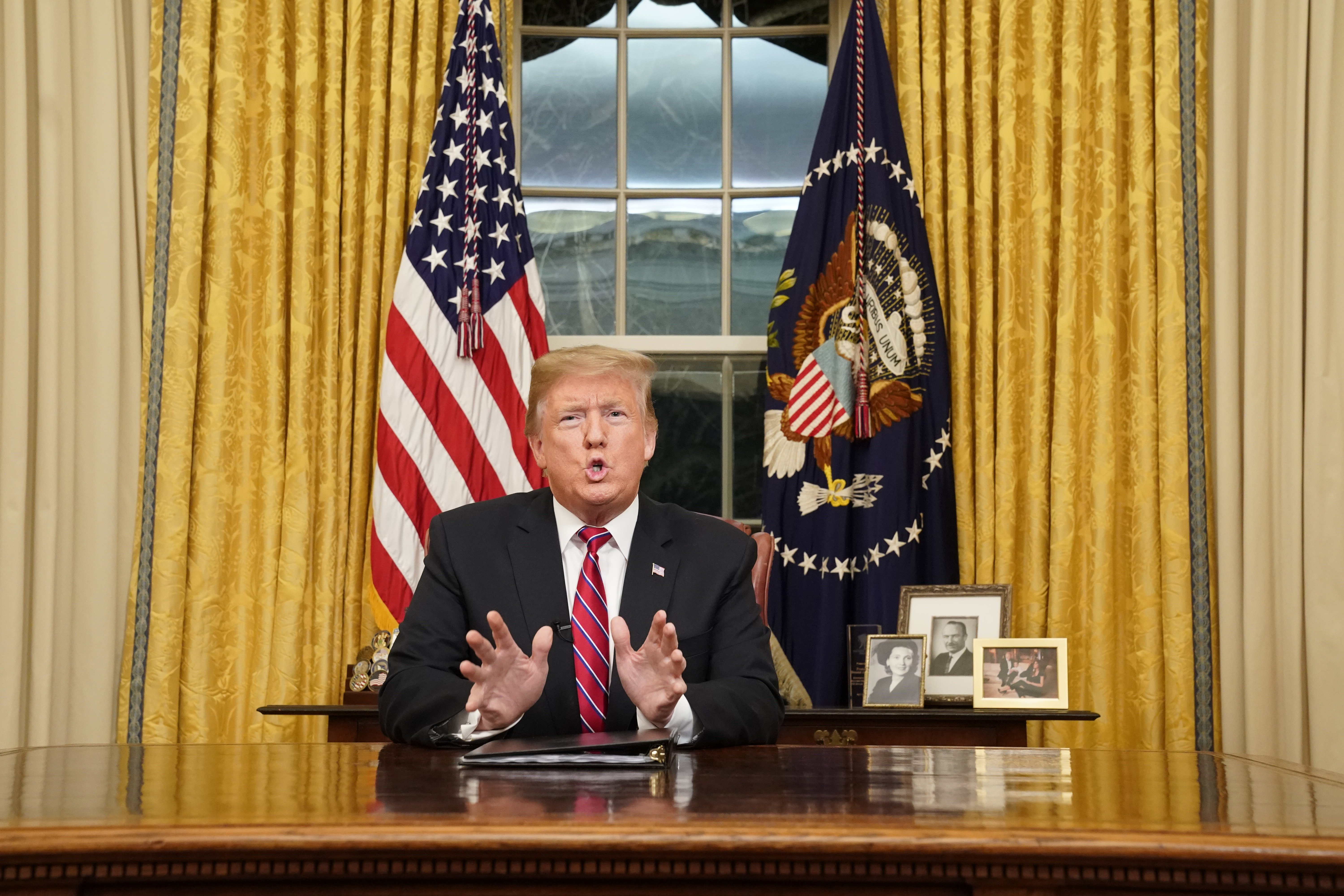 Donald Trump speaking to the nation in his first-prime address from the Oval Office of the White House | Photo: Getty Images