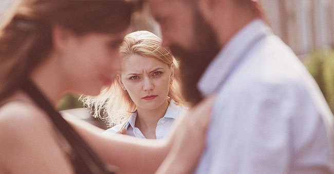 A woman looking at a couple.   Source: Shutterstock
