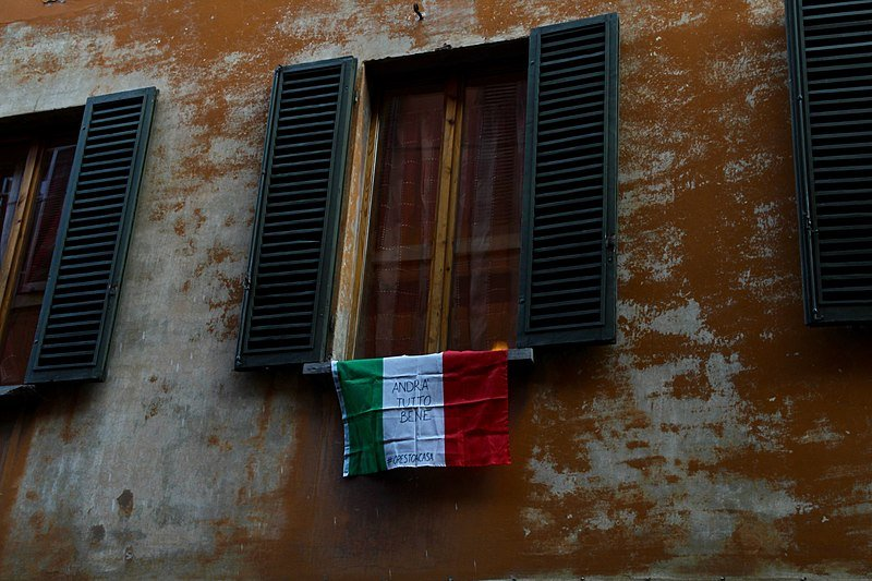 "An Italian flag hung outside of a window in Bologna with the slogan ""Andrà tutto bene"" (Everything is gonna be fine) during the COVID-19 pandemic on March 19, 2020 