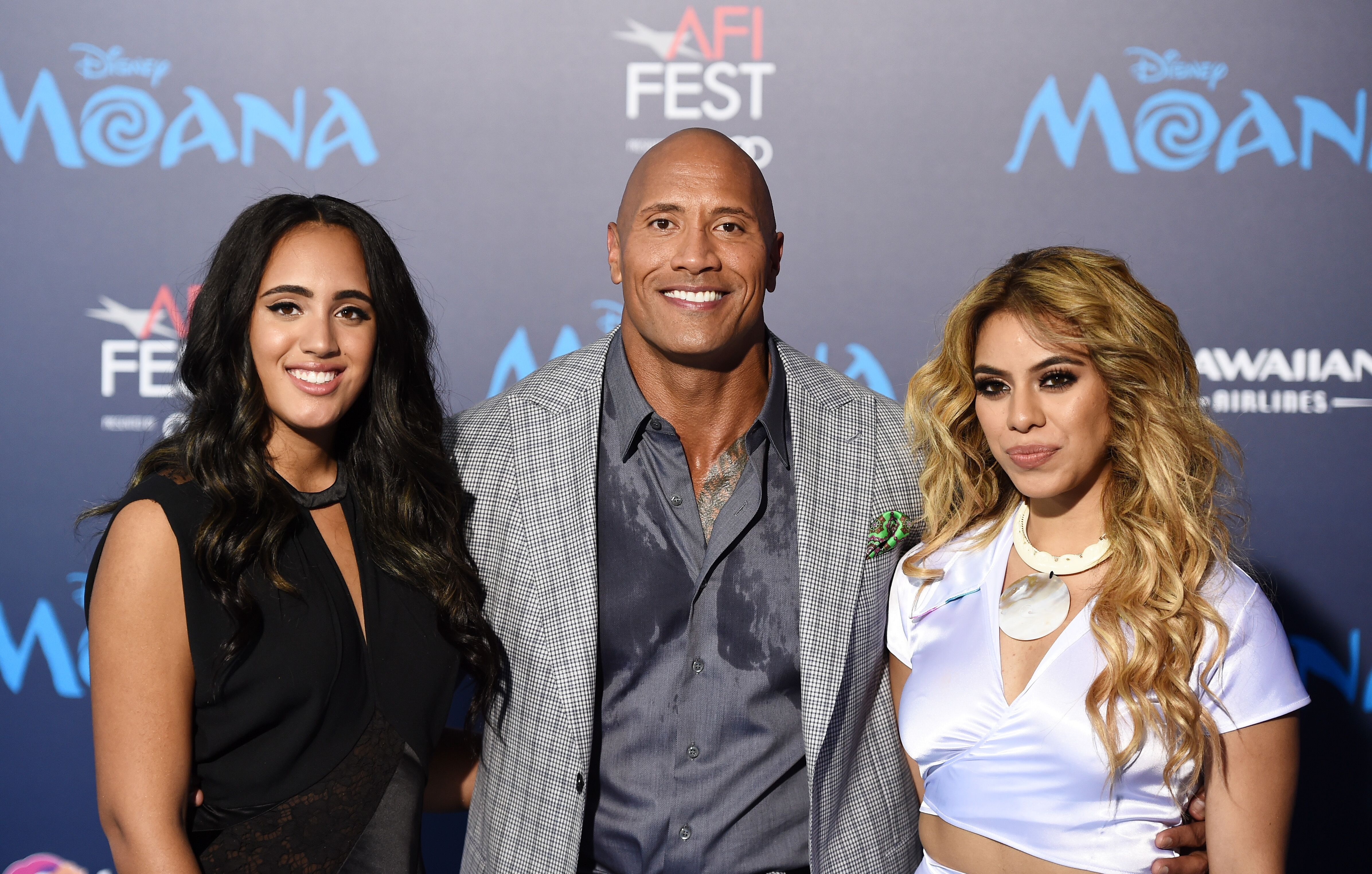 """HOLLYWOOD, CA - NOVEMBER 14: (L-R) Simone Alexandra Johnson, actor Dwayne Johnson and singer Dinah Jane Hansen arrive at the AFI FEST 2016 Presented By Audi premiere of Disney's """"Moana"""" at the El Capitan Theatre on November 14, 2016 in Hollywood, California. (Photo by Amanda Edwards/WireImage)"""