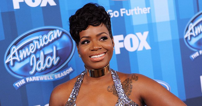 Fantasia Gushes over Her Daughter Zion Posing in an Orange Top, Showing Her Hyaline Sunglasses