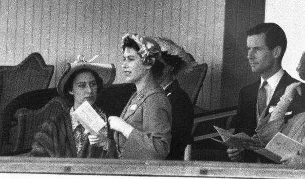 Princess Margaret, Queen Elizabeth II and Group Captain Peter Townsend on June 13, 1951 in the Royal Box at Ascot | Photo: Getty Images