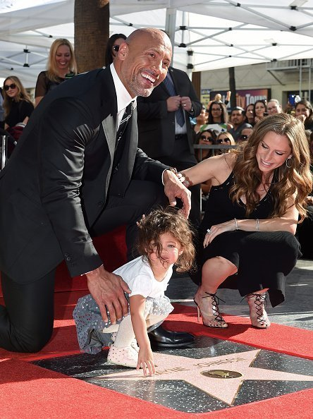 Dwayne Johnson, wife Lauren Hashian and daughter Jasmine Johnson on the Hollywood Walk of Fame on December 13, 2017 | Photo: Getty Images