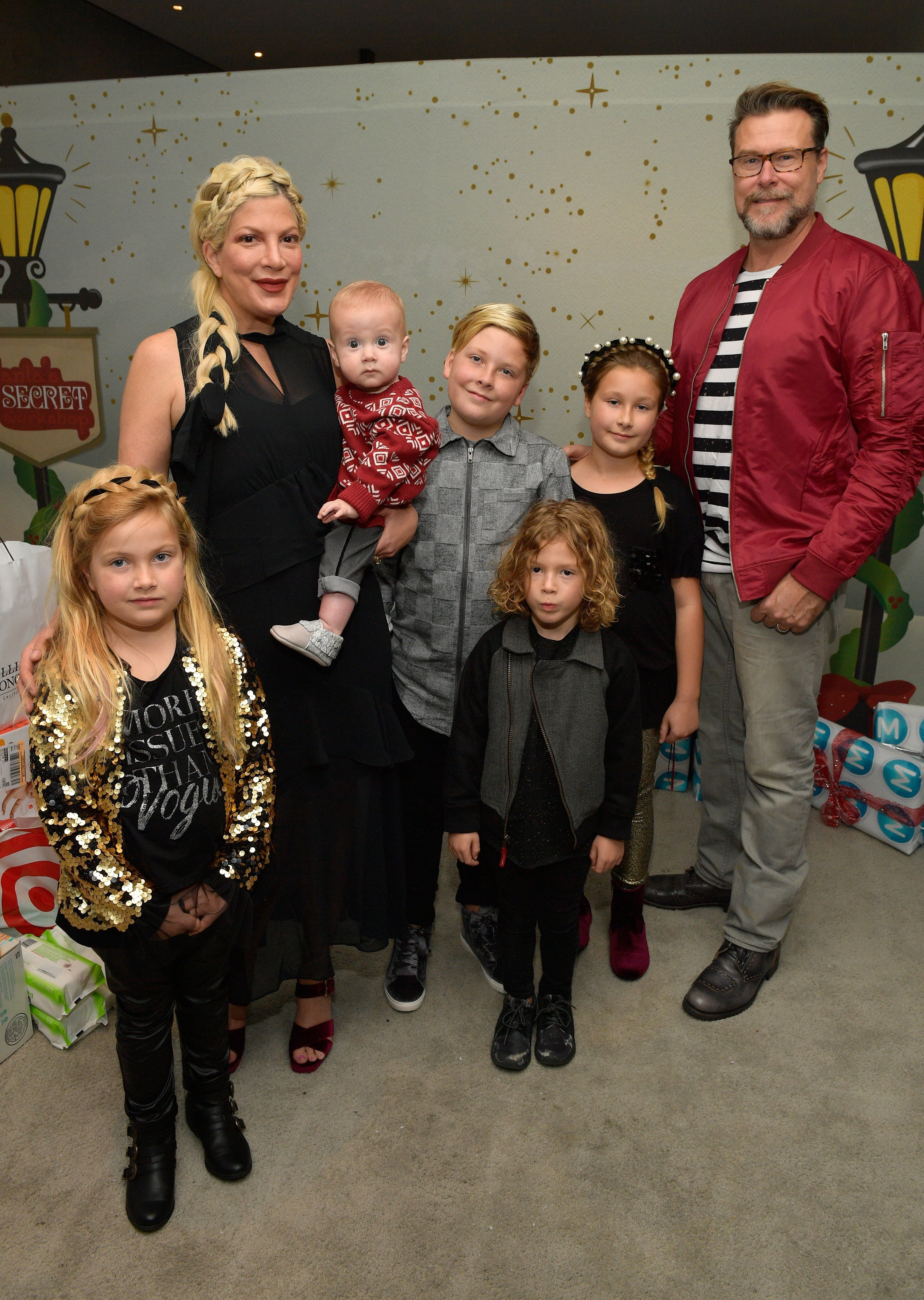 Tori Spelling, Dean McDermott, and their children at the 7th Annual Santa's Secret Workshop benefiting LA Family Housing. | Source: Getty Images