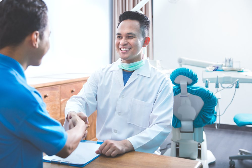The dentist tried his best to answer the man's questions.   Photo: Shutterstock