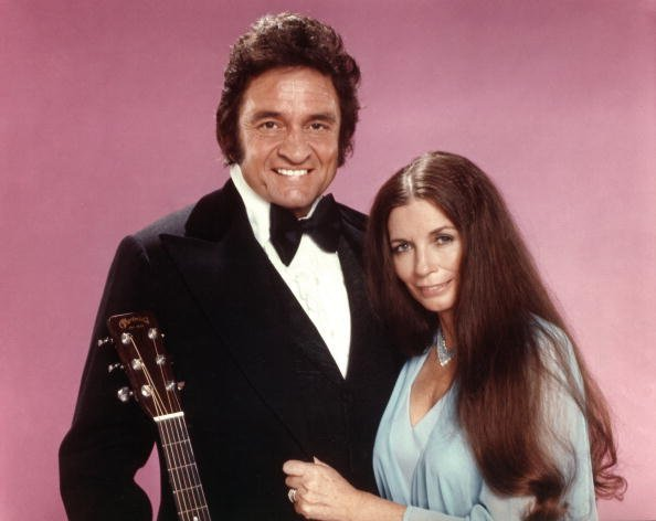 Johnny Cash and June Carter Cash pose for a portrait in 1975. | Photo: Getty Images