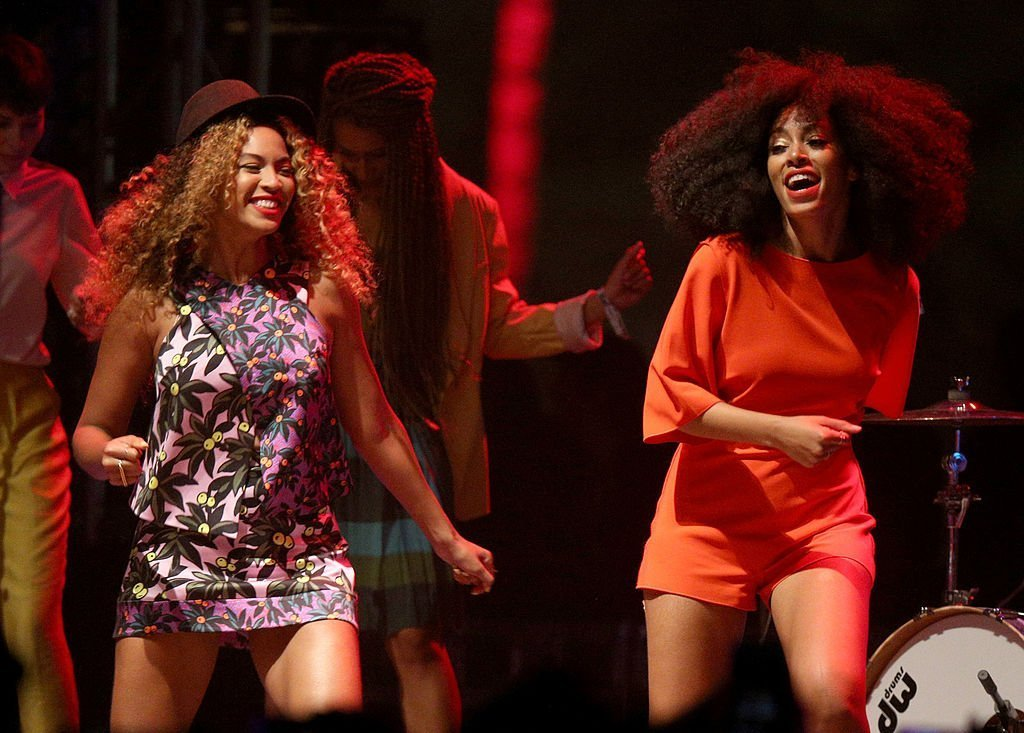 Beyonce performs with her sister Solange Knowles onstage during day 2 of the 2014 Coachella Valley Music & Arts Festival at the Empire Polo Club in Indio, California | Photo: Getty Images