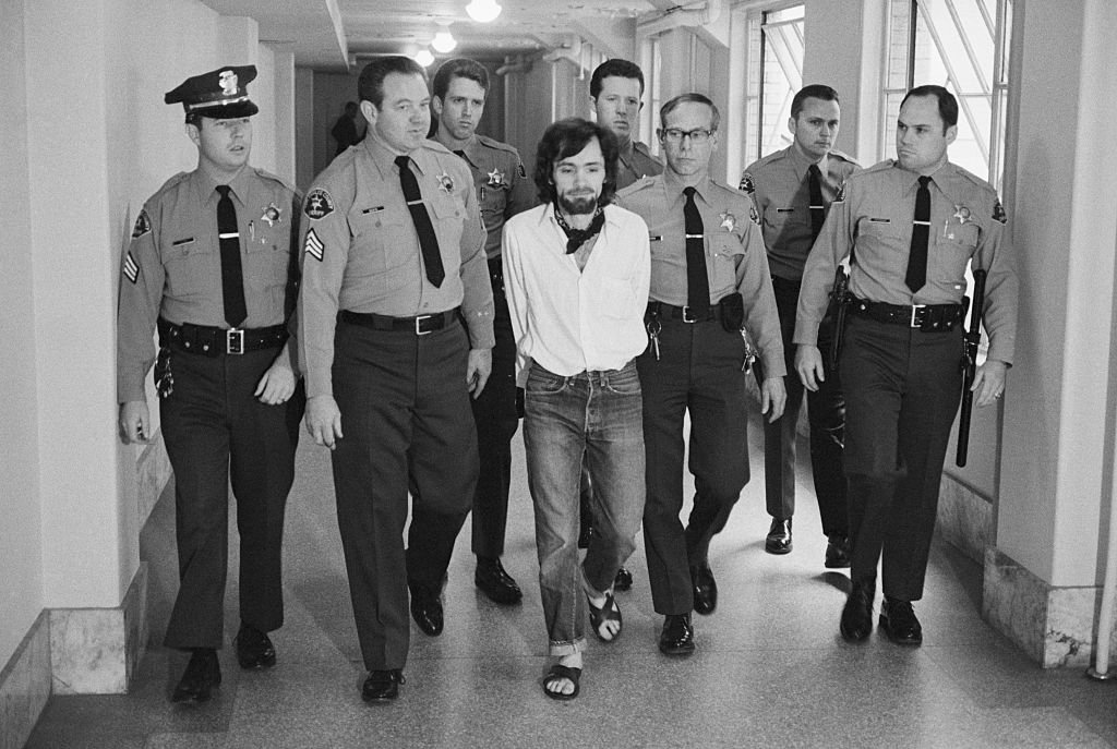 Seven deputies escort Charles Manson from the courtroom after he and three followers were found guilty of seven murders in the Tate-LaBianca slayings. | Photo: Getty Images
