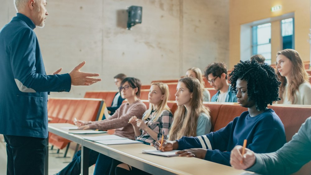 A professor holding lecture in a university. | Photo: Shutterstock