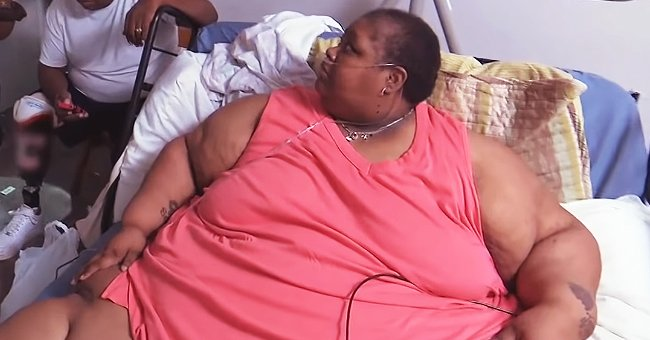 """""""My 600-LB Life"""" star Teretha Hollis-Neely laying on a bed during an appearance on the TLC show, """"My 600-Lb Life."""" 