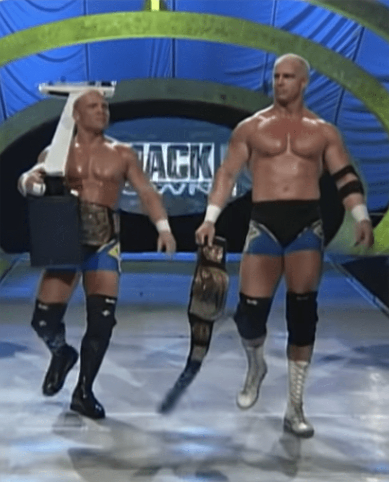 On-stage wrestling cousins Hardcore and Crash Holly walking toward the ring for a match with mankind and Al Snow in November 1999. I Image: YouTube/ WWE.
