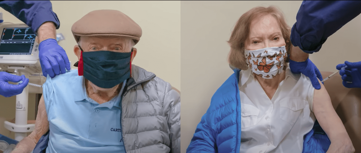 Screenshot of former president Jimmy Carter and his wife getting vaccinated.   Source: Youtube/AdCouncil