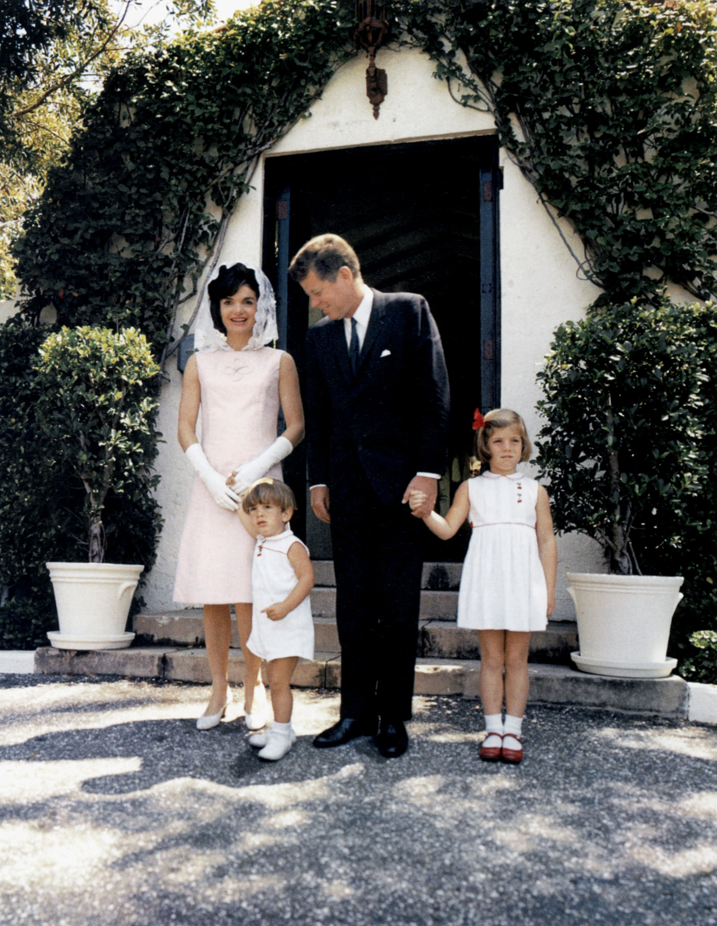 Jacqueline Kennedy with President John F. Kennedy and their two children John Jr and Caroline at Palm Beach, Florida on April 14, 1963   Photo: Getty Images